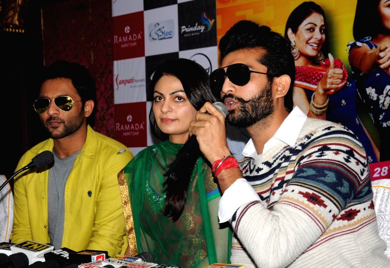 Starscast of upcoming Punjabi movie `Proper Patola` Neeru Bajwa, Yuvraj Hans and Harish Verma during a press confrence in Amritsar, on Nov 26, 2014. - Harish Verma
