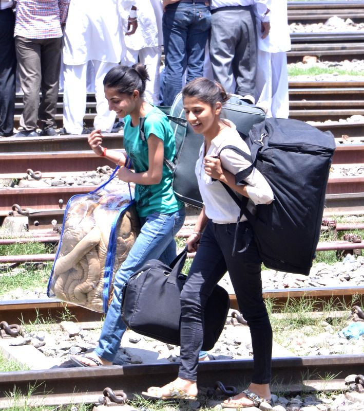 Stranded passengers at Amritsar railway station as services of trains were distupted due to Congress demonstration in Amritsar, on May 2, 2015.