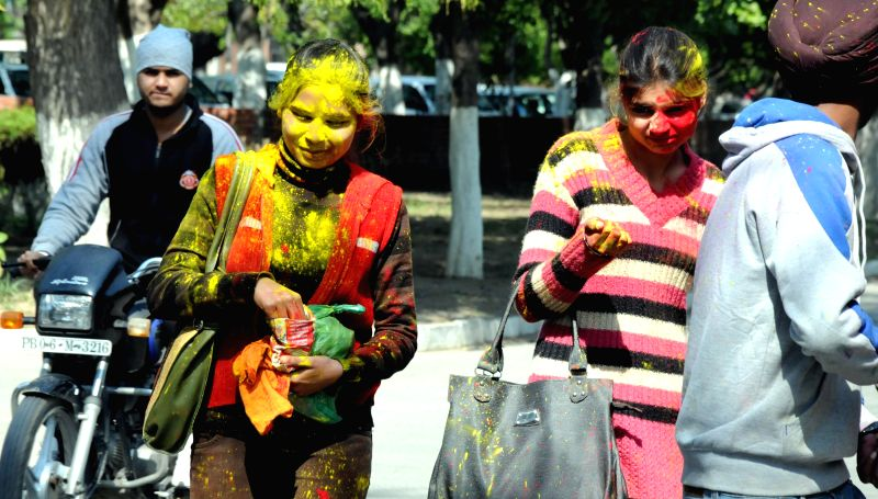 Students celebrate holi in Amritsar on March 4, 2015.