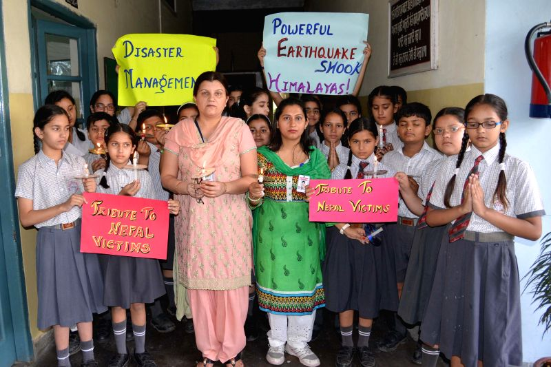 Students pay tribute to the victims of Nepal earthquake in Amritsar, on April 27, 2015.