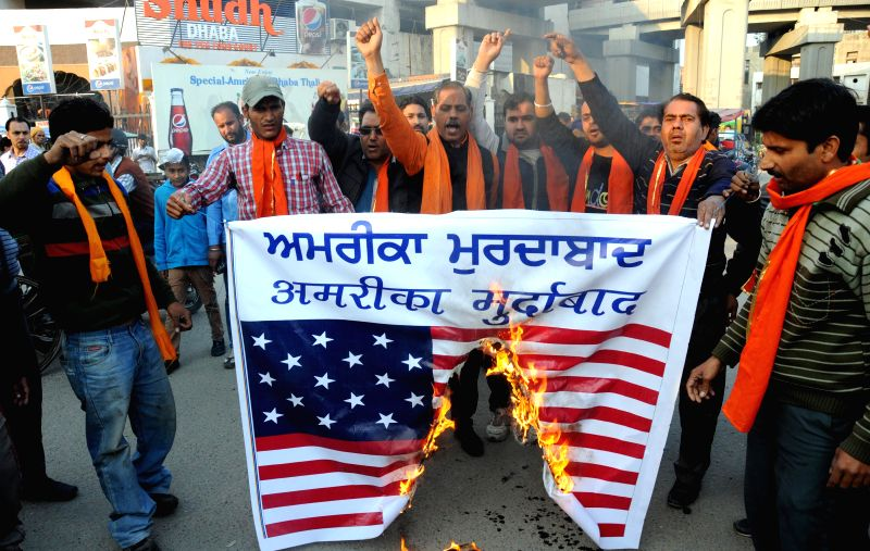 The activists of Shiv Sena Samajwadi protest against racial attack on a young Sikh boy in Georgia, US;  in Amritsar, on March 3, 2015.