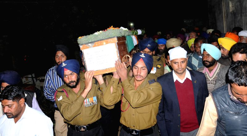 The body of gunner Satnam Singh who was killed while fighting with militants in Uri sector of Jammu and Kashmir brought at his native village Pandori near Amritsar on Dec. 6, 2014.