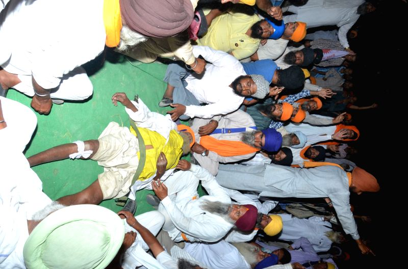 The body of Joginder Singh, a septuagenarian farmer who died at the site of a farmers' demonstration near Amritsar on April 28, 2015. - Joginder Singh