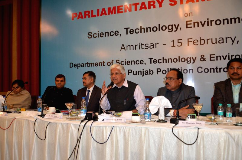 The Chairman of the Parliamentary Standing Committee on Science and Technology, Environment and Forests Ashwani Kumar (C) addresses a press conference in Amritsar, on Feb 15, 2015.