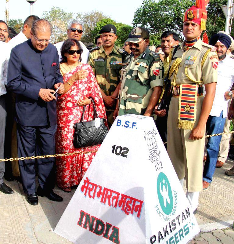 The Mauritius President Rajkeswur Purryag with his wife Aneetah Purryag visits Attari international border in Amritsar, on April 20, 2015.