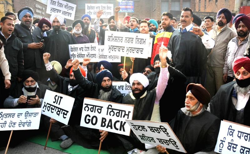The members of Hotels and Guest Houses Association demonstrate against administration`s plan of sealing of illegal hotels near the Golden Temple and Jallianwala Bagh in Amritsar on Dec 15, .