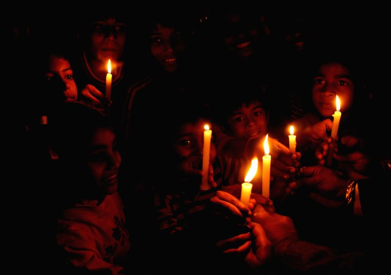 The members of International Human Rights Organisation participate in a candlelight vigil organised on the Human Rights Day in Amritsar, on Dec 10, 2014.