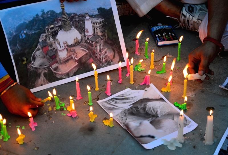 The members of International Human Rights Organisation participate in a candlelight vigil organised to pay tribute to Nepal earthquake victims in Amritsar, on May 1, 2015.