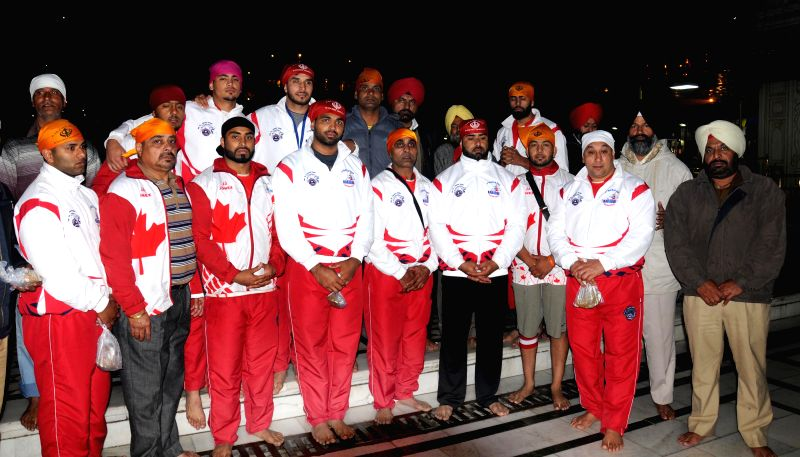 The members of the Canadian kabaddi team (men's) pay obeisance at the Golden Temple in Amritsar, on Dec 17, 2014.