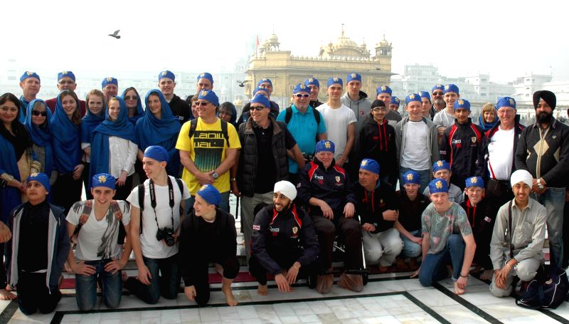 The members of the UK men's and women's under 15 Hockey team visit the Golden Temple in Amritsar, on Dec 17, 2014.