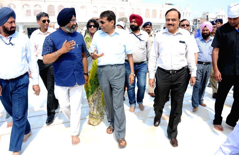 The Union Minister for Railways Suresh Prabhakar Prabhu pays obeisance at the Golden Temple in Amritsar, on April 5, 2015. - Suresh Prabhakar Prabhu
