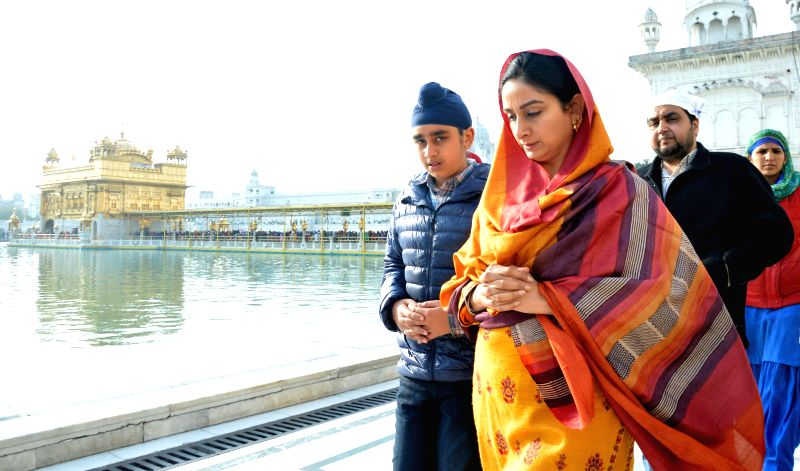 Union Minister for Food Processing Industries Harsimrat Kaur Badal pays obeisance at the Golden Temple in Amritsar on Feb 8, 2015.