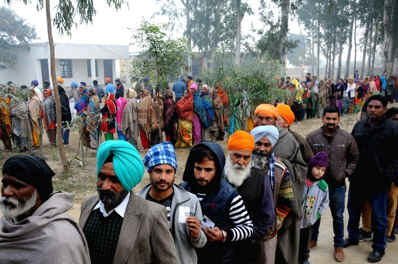 Amritsar: Voters wait in multiple queues to cast their votes for Punjab panchayat elections, at a polling booth in Amritsar on Dec 30, 2018.