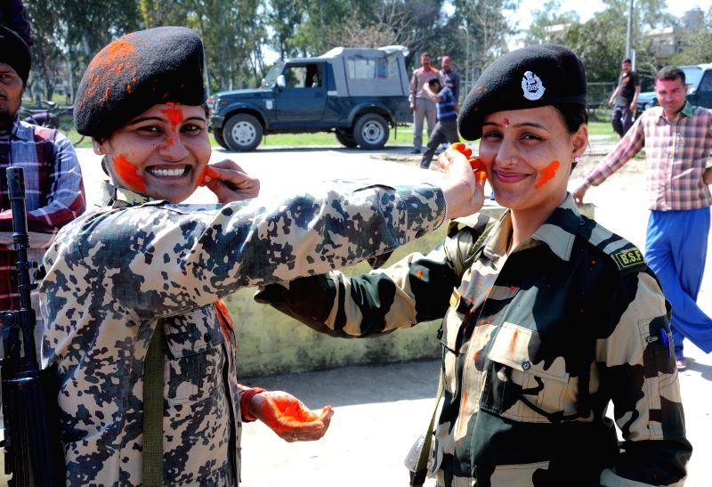 Women officers of BSF celebrate Holi in Amritsar, on March 6, 2015.