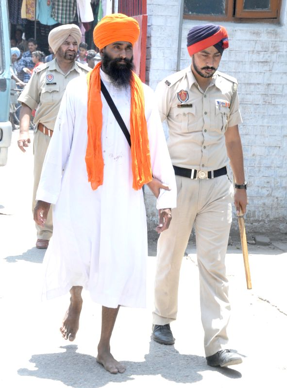 Youths involved in Golden Temple clash being taken for medical examination at an Amritsar Hospital on June 7, 2015.