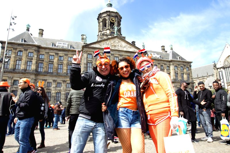 AMSTERDAM, April 27, 2017 - People celebrate the Netherlands' traditional King's Day at the Dam Square in front of the Royal Palace in Amsterdam on April 27, 2017. The Dutch's King's Day is the ...