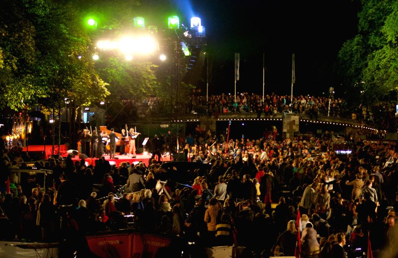 A concert with the stage built on the Prince Canal was held in Amsterdam on August 23, 2014, with hundreds of audience on boats, standing along the canal or on ...