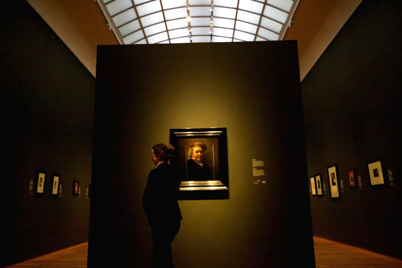 A staff member looks on during the Late Rembrandt exhibition at the Rijksmuseum in Amsterdam, the Netherlands, Feb. 12, 2015. The exhibition showing the late ...