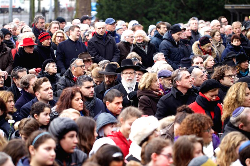 Dutch people attend a silent march in Amsterdam, Netherlands, on Jan. 25, 2015. During the annual National Holocaust Remembrance in Amsterdam on Sunday Mayor ...