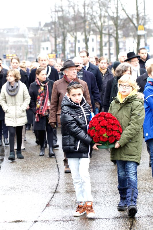Dutch people place a wreath at the Auschwitz monument in the Wertheimpark in Amsterdam, Netherlands, on Jan. 25, 2015. During the annual National Holocaust ...