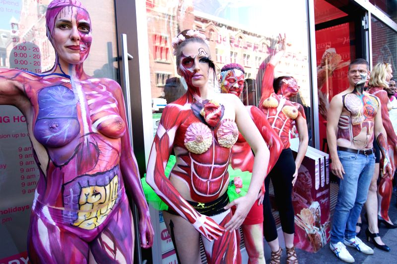 """Body painting models pose during """"Under Your Skin"""", an exhibition featuring anatomical body paintings, at Dam Square in downtown Amsterdam, Netherlands, ..."""