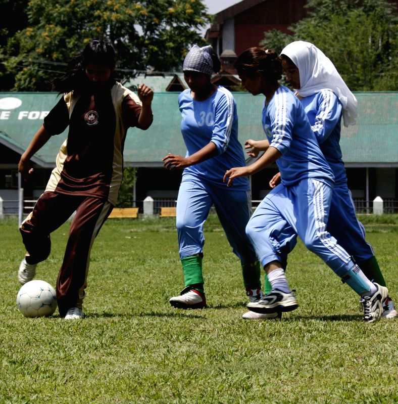 An action moment during Final Match of Women's Football Tournament 2014 played between Govt. Women's College M.A Road and Mallinson Girls High School Srinagar at the grounds of Women's College ...