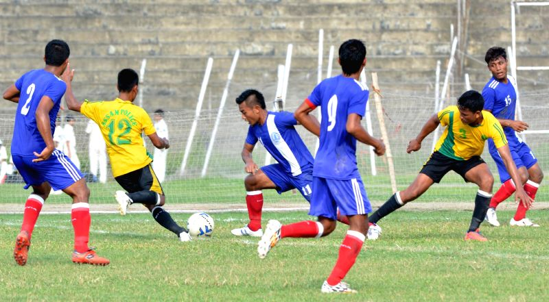 An action moment during the 10th NN Bhattacharya Football Tournament played between Assam Police (yellow jersey ) and Assam State Electricity Board (ASEB) organised by Guwahati Sports Association, at
