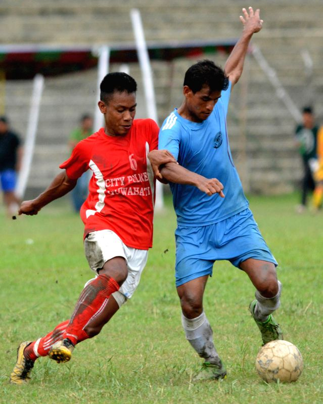 An action moment during the 10th NN Bhattacharya Football Tournament semi-final match played between N.F. railway (blue jersey) and City Police Guwahati at Nehru Stadium in Guwahati on July 17, 2014.