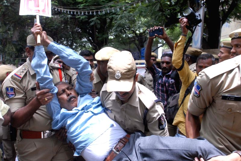 An activist being taken away during a demonstration against the Central Government, jointly organised by Centre of Indian Trade Unions (CITU), All India Kisan Sabha (AIKS) and All India ...