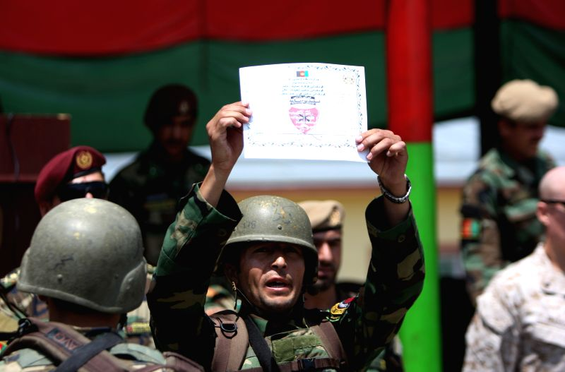 An Afghan army soldier shows his certificate during his graduation ceremony in Kabul, Afghanistan, July 29, 2015. A total of 138 members of Afghan National army ...
