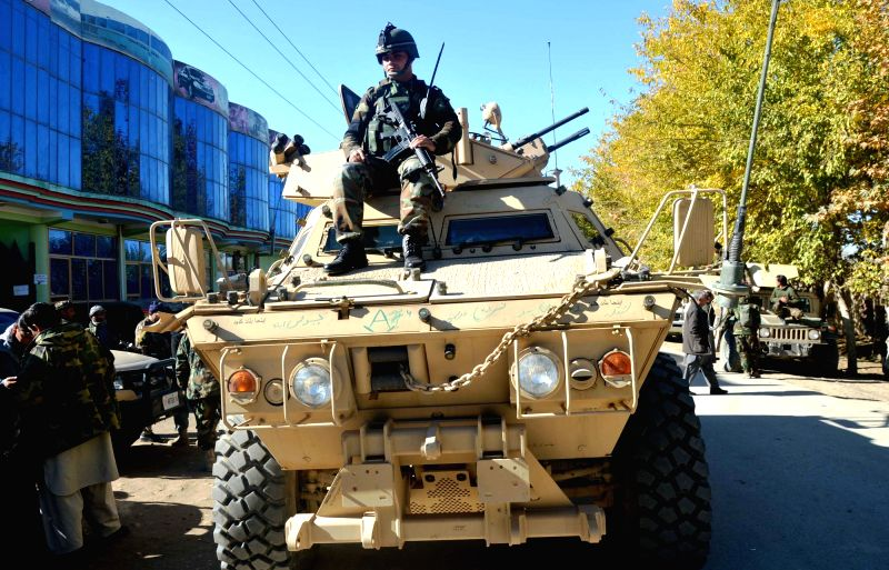 An Afghan army soldier sits on a military vehicle during a military operation in Imam Sahib district, Afghanistan's northern Kunduz province, Nov. 17, 2015. Up to 10 ...