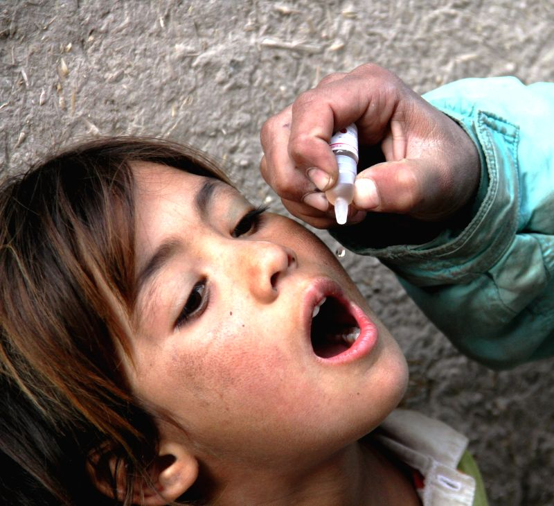 An Afghan child receives a polio vaccination during an anti-polio campaign in Nangarhar province, eastern Afghanistan, Dec. 2, 2015. Afghanisan is one of the ...
