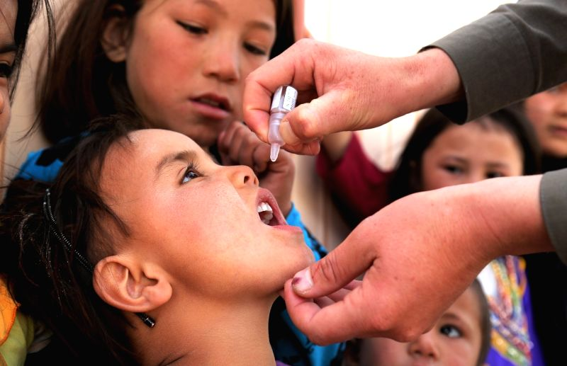 An Afghan child receives a polio vaccine during a vaccination campaign in Ghazni city, capital of eastern Ghazni province of Afghanistan, Nov. 2, 2015. ...