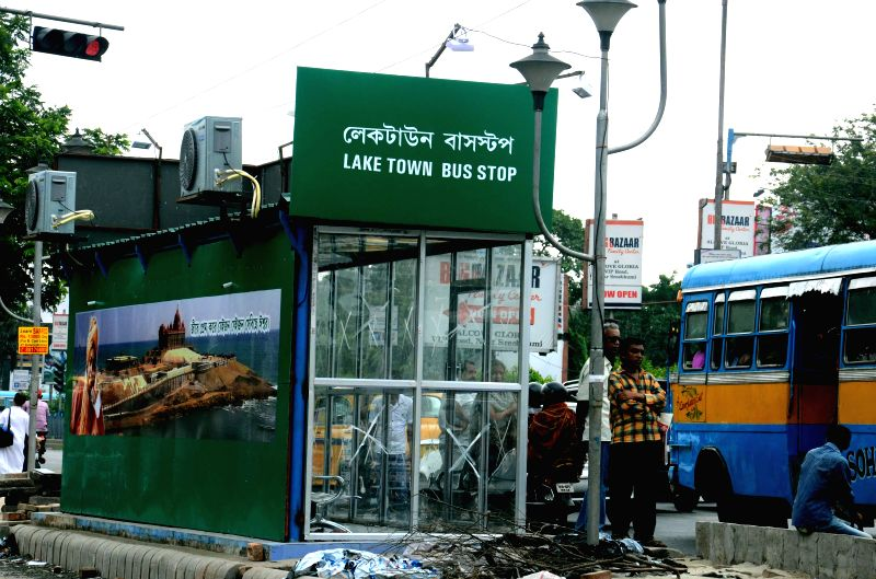 An air-conditioned bus-stop for commuters on VIP Road at Lake Town in Kolkata on July 9, 2014.