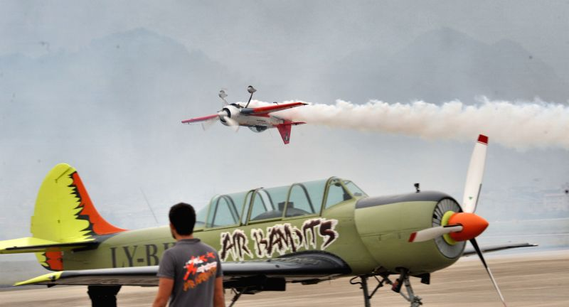 An aircraft performs aerobatics during an international aviation tourism festival in Zhangjiajie, east China's Hunan Province, Oct. 30, 2015. The aviation ...