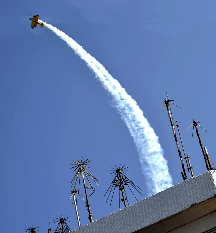 An airplane performs aerobatics at the Aero India Show 2015, at Yelahanka Air-force Station, in Bengaluru on Feb 22, 2015.