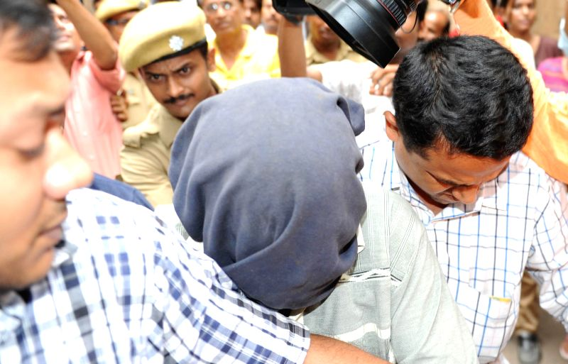 An alleged terrorist who is being tried for being involved in Pune blast being taken to be produced in a Kolkata court on July 3, 2014.