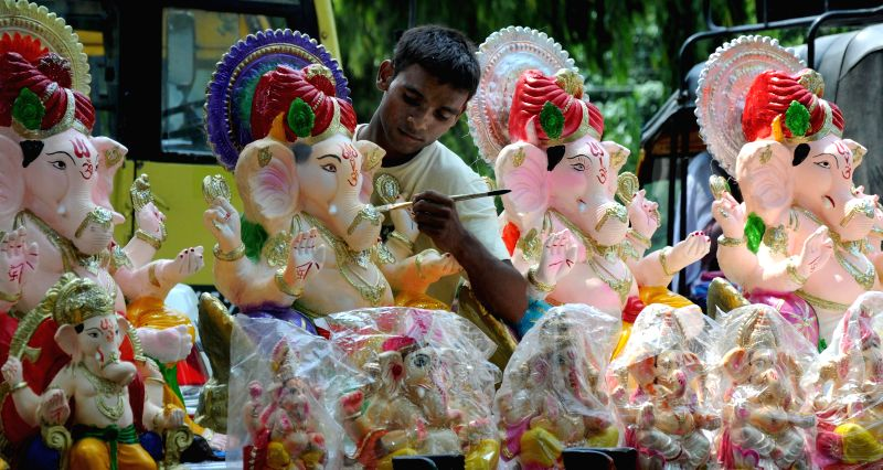 An artist gives final touches to Ganesha idols ahead of Ganesh Chaturthi in Amritsar on Aug 6, 2014.