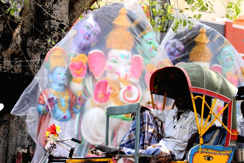 An artist paints Ganesh idols ahead of Ganesh Chaturthi in Chennai on Aug 10, 2016.