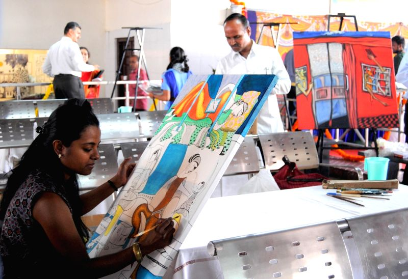 An artist participates in Art Camp Safar 2016 organised by Alley and South Western Railways in Bengaluru on April 5, 2016.