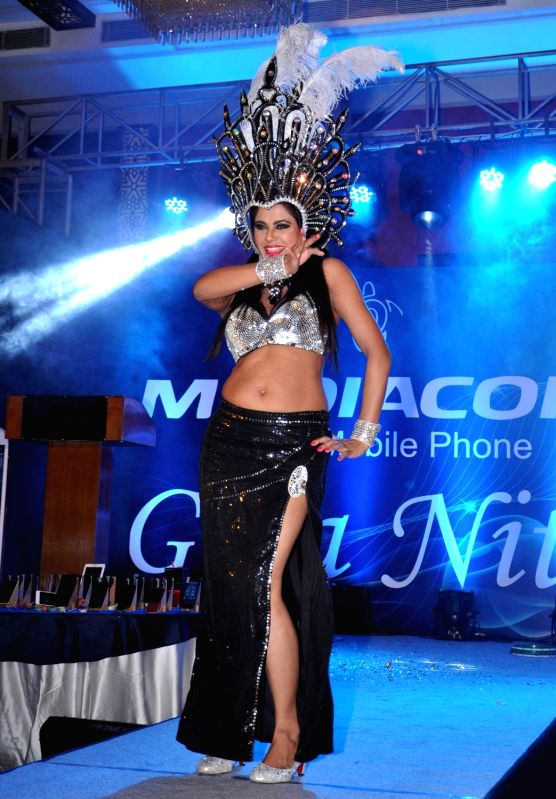 An artist perform during mobile launching in Kolkata on Nov 20, 2015.