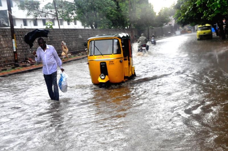 An auto rickshaw struggles through flooded streets of Secunderabad on Aug 26, 2014.