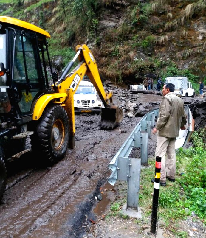 An earth-mover pressed into service to clear roads blocked due to landslide in Rudraprayag of Uttarakhand  on May 23, 2016.