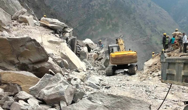 An earth-mover pressed into service to repair roads destroyed due to landslide that led to the closure of Badrinath highway in Chamoli district of Uttarakhand on May 20, 2017.