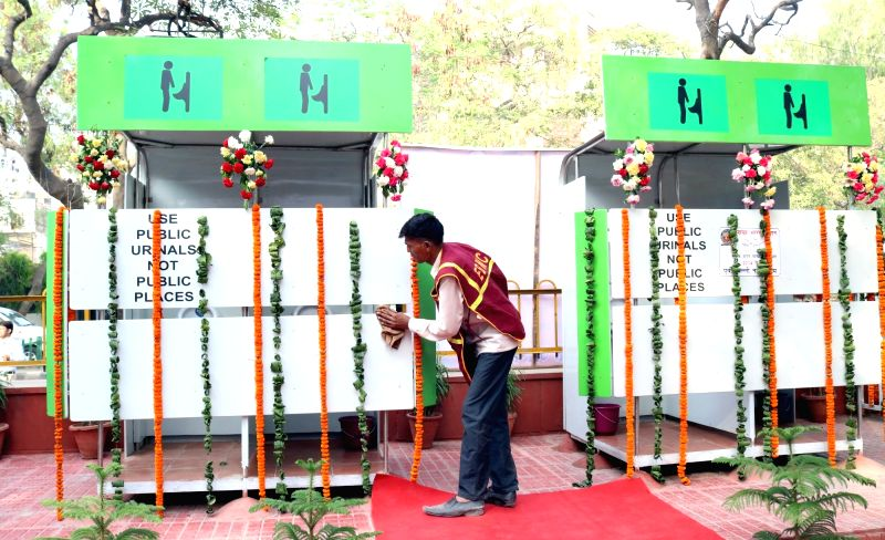 An East Delhi Municipal Corporation (EDMC) worker busy cleaning a NAMMA public toilet - sensor-based solar toilets, suggested by former president late APJ Abdul Kalam - ahead of its ...