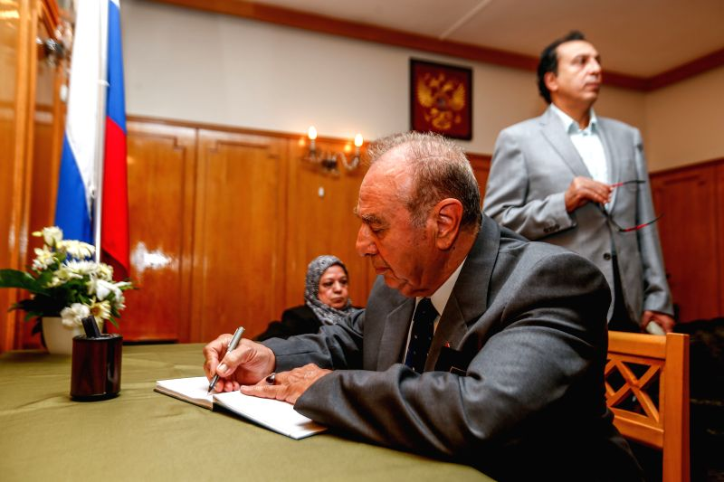 An Egyptian man writes his message of condolences on a guest book at the Russian embassy in Cairo on Nov. 2, 2015. Some 144 victims' bodies in a Russian airliner crash ...