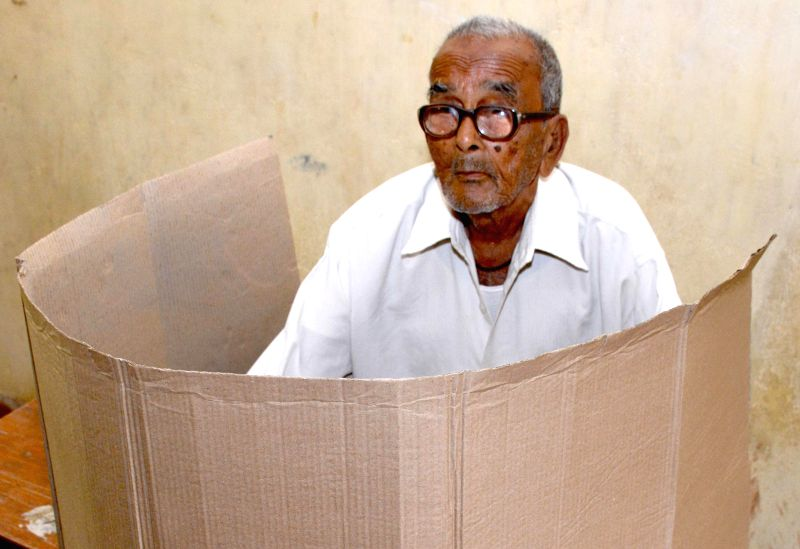 An elderly gentleman casts his vote  at a polling booth during the sixth phase of 2014 Lok Sabha Polls in Guwahati on April 24, 2014.