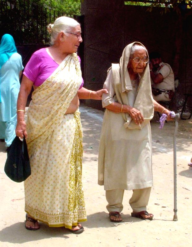 An elderly lady arrives to cast her votes during Municipal Corporation of Delhi (MCD) by-polls in New Delhi, on May 15, 2016.