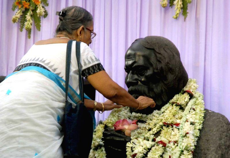 An elderly lady pays tribute to Rabindranath Tagore on his birth anniversary at Jorasanko Thakur Bari in Kolkata, on May 8, 2016.