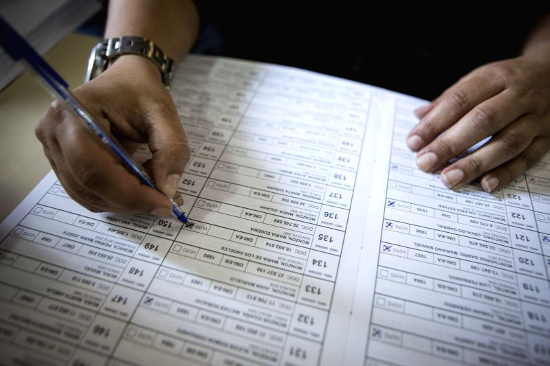 An electoral official marks the vote of a citizen in a polling station of Buenos Aires, Argentina, on Nov. 22, 2015. The ruling Front for Victory party ...